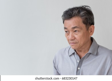 angry, upset, unhappy, frustrated, unfriendly middle age old asian man looking at you