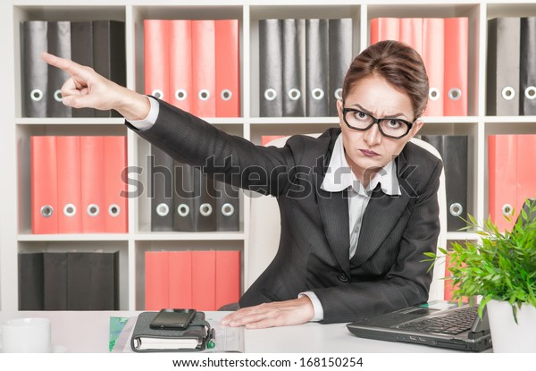 Angry woman boss pointing out