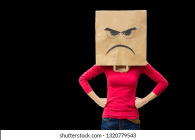 Angry woman carries paper bag isolated on black background