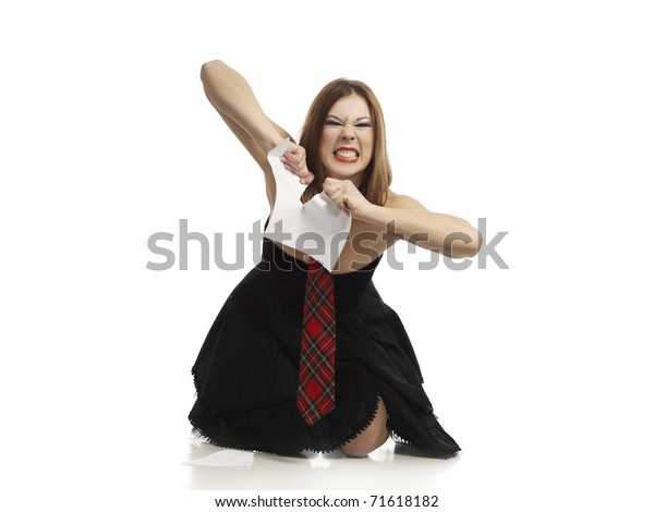 angry woman destroying a piece of paper
