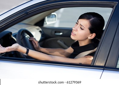 Angry woman driver stuck in traffic jam