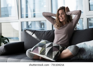 Angry woman feeling pain in head
