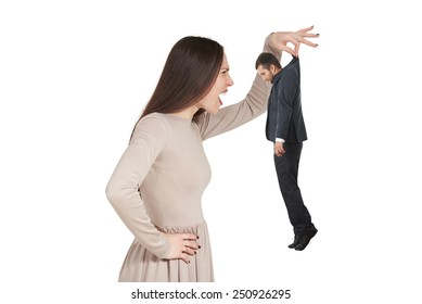 angry woman holding small man and yelling at him. isolated on white background