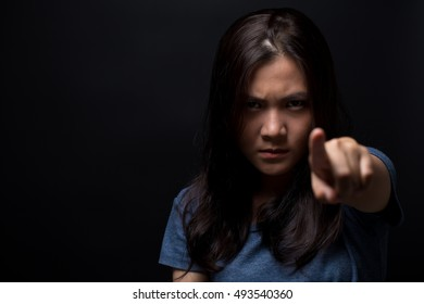 Angry woman pointing to front