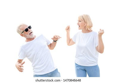 Angry woman screaming against at her husband in a discussion on white background