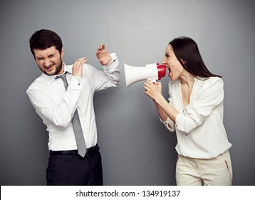 angry woman shouting at the man over dark background