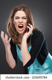 angry woman shouts in phone. Negative emotions on a face. Studio female portrait