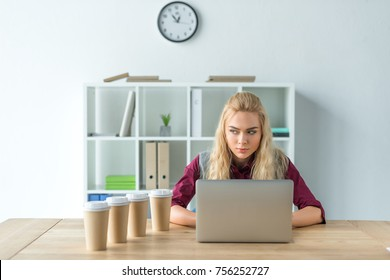 Angry woman sitting at the laptop in the office