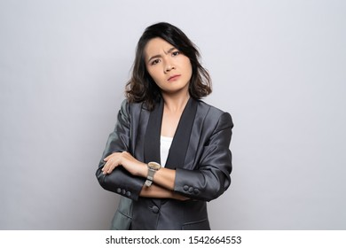 Angry woman standing isolated over white background