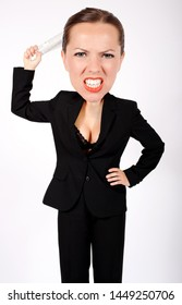 angry woman in suit with big head holding a rolled up newspaper