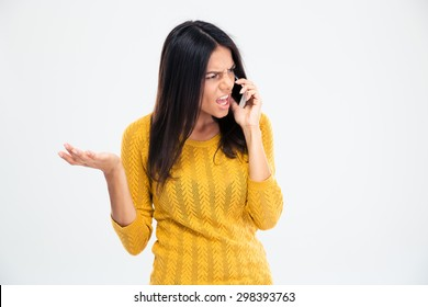 Angry woman talking on the phone isolated on a white background