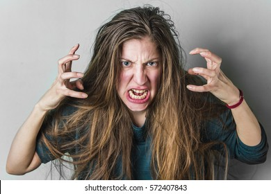 Angry woman yelling, caucasian girl with long hair screaming with rage