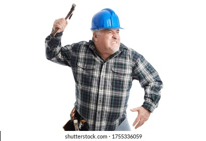 Angry workman raises hammer, wearing helmet, isolated on white.