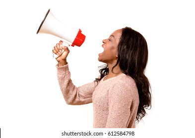 Angry young African woman yelling into a megaphone as she makes her grievances known at a demonstration or rally, side view on white