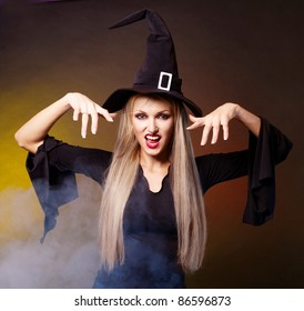 angry young blond witch with  clouds of blue smoke around her,against black and yellow background