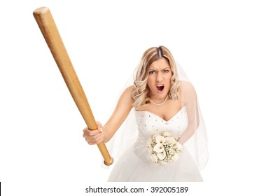 Angry young bride holding a baseball bat and yelling isolated on white background