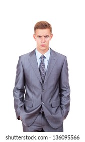 angry young business man serious, businessman with hands in pocket wear elegant suit and tie isolated over white background