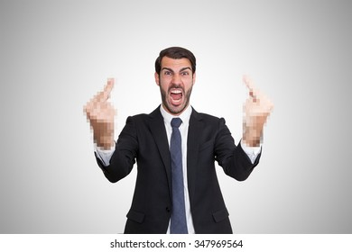 Angry young business man showing censored fingers at camera.