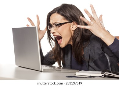 angry young businesswoman shouting at her laptop