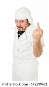 Angry young chef sticking up the middle finger in white background