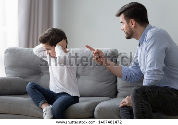 Angry Young Dad Sit On Couch Stock Photo Edit Now 1407481472