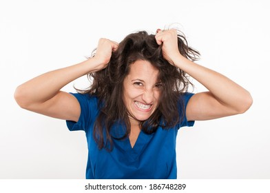 Angry young female doctor in blue coat pulling her hair