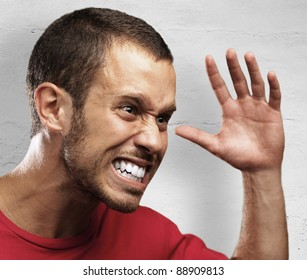 angry young man against a grunge background