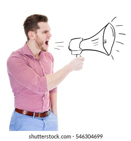 Angry young man screaming in megaphone isolated on gray background. Negative face expression emotion feeling. Propaganda, breaking news, power of social media concept