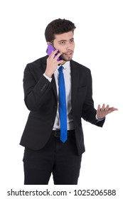 An angry young man in a suit talking on the phone negotiation, isolated on a white background.