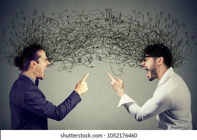 Angry young men screaming at each other exchanging with negative thoughts