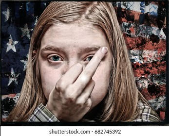 An Angry Young Political Activist Exercising Her First Amendment Rights by Flipping the Bird in Front of a Grungy American Flag in Protest to Government and Electoral Corruption