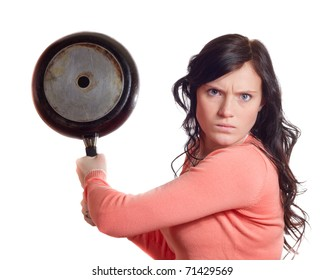 Angry young woman with rage in face and saucepan in one hand