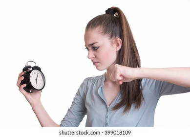 Angry young woman wants to break her alarm clock
