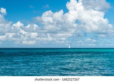 Anguilla, Caribbean beach landscape, boat sailing in the ocean