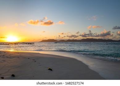 Anguilla, Caribbean beach landscape, Saint Martin in the distance at sunrise