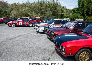 ANGUILLARA SABAZIA, LAZIO, ITALY - APRIL 6, 2014: Lancia Delta HF Integral Martini Racing and Lancia Fulvia vintage cars participating at the 11-th meeting of spring memorial Luciano Polverari.