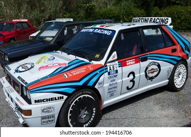 ANGUILLARA SABAZIA, LAZIO, ITALY - APRIL 6, 2014: White  Lancia Delta HF Integral Martini Racing participating at the 11-th meeting of spring memorial Luciano Polverari.