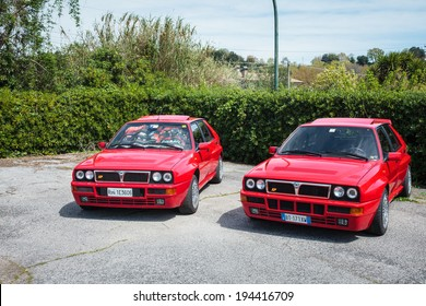 ANGUILLARA SABAZIA, LAZIO, ITALY - APRIL 6, 2014: Red Lancia Delta vintage rally cars participating at the 11-th meeting of spring memorial Luciano Polverari.