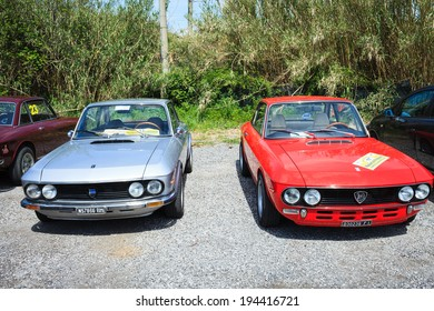 ANGUILLARA SABAZIA, LAZIO, ITALY - APRIL 6, 2014: Red and silver vintage Lancia Fulvia cars, participating at the 11-th meeting of spring memorial Luciano Polverari.