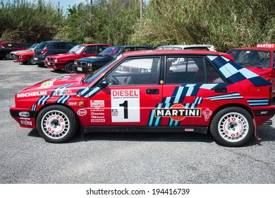 ANGUILLARA SABAZIA, LAZIO, ITALY - APRIL 6, 2014: Red Lancia Delta HF Integral Martini Racing participating at the 11-th meeting of spring memorial Luciano Polverari.