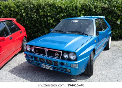 ANGUILLARA SABAZIA, LAZIO, ITALY - APRIL 6, 2014: Blue  Lancia Delta HF Integral Martini Racing participating at the 11-th meeting of spring memorial Luciano Polverari.
