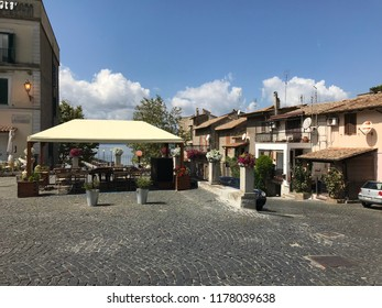 ANGUILLARA SABAZIA, LAZIO, ITALY - SEPTEMBER 7, 2018: The outdoor restaurant Lo Sfizio Del Lago in Piazza Del Lavatoio.