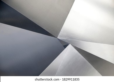 Angular metal panels. Steel sheets resembling abstract modern architecture exterior or interior detail. Industrial background in hi-tech style. Polygonal geometric pattern of triangles.