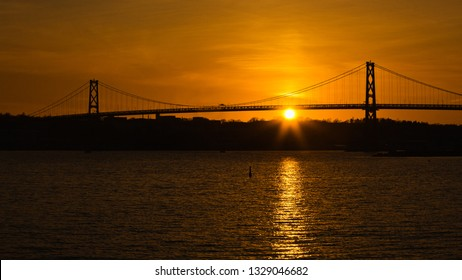Angus L. Macdonald Bridge at sunset. The span connects Halifax and Dartmouth, Nova Scotia.