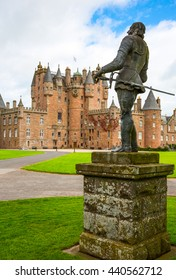 Angus, Scotland - July 27, 2012:  Fife area, the Glamis castle, childhood home of the Queen Elizabeth. In the foreground the King Charles II statue.