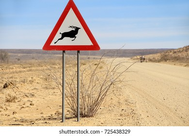 Animal Crossing Sign: A road sign warns of animals in the road ahead.