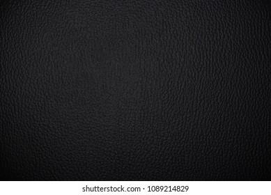 Animal dark skin surface. Matte black leather texture
