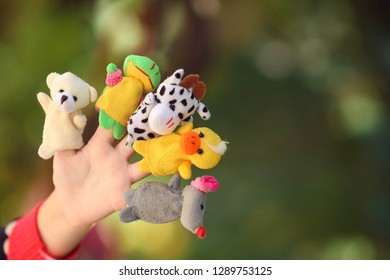 Animal dolls child playing on fingers.