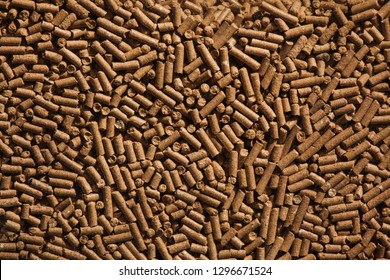 Animal food pellets. Background texture.