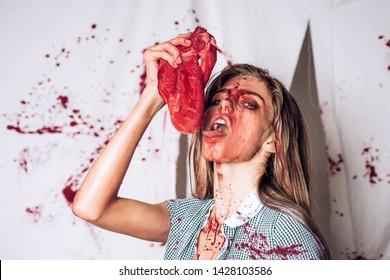 animal hunger. meatman in butcher shop, butchery. cannibalism. donation and donar. bloody halloween. anatomy. zombie. medical transplantation. woman in blood. human internal organ trade Ribeye steak
